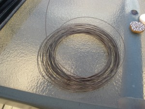 A roll of uncut 22 gauge wire in Antiqued Brass finish